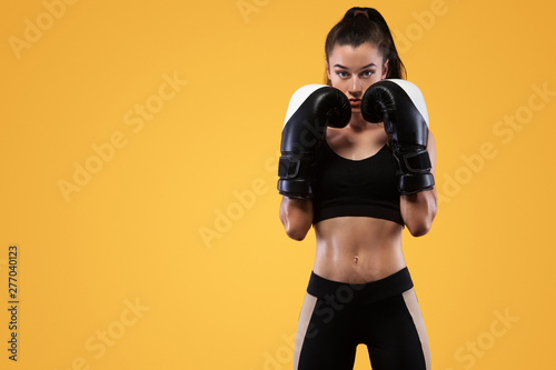 Fotografía Sportsman, woman boxer fighting in gloves
