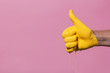 """canvas print picture male hand showing sign thumb up with paint flowing down on a colored background. creative idea, creative concept, gesture """"class"""""""