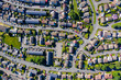 Aerial drone view of small winding sreets and roads in a residential area of a small town
