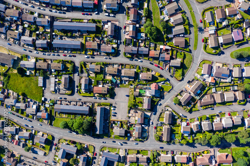 Fotografija Aerial drone view of small winding sreets and roads in a residential area of a s