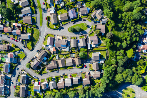 Aerial drone view of small winding sreets and roads in a residential area of a s Fototapeta