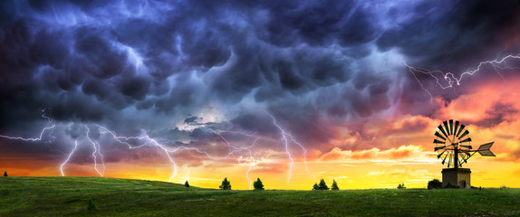 Thunderstorm And Lightning At Sunset In Country Field