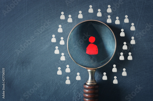 business image of magnifying glass with people icon over chalkboard background, Canvas Print