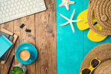 Summer holiday vacation concept with beach accessories and office desk background. Top view from above