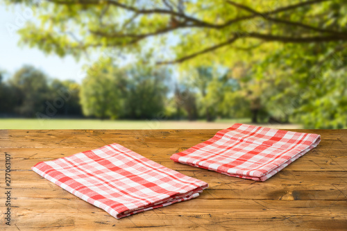 Door stickers India Empty wooden table with tablecloth over autumn nature park background