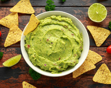 Bowl Of Fresh Guacamole With N...