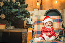 First Christmas Magic. Merry Christmas And Happy New Year. Child Toddler Relax At Home Christmas Eve. Believe In Christmas Miracle. Winter Holidays. Wish Meet Santa Claus. Happy Childhood. Life Event