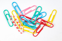Colored Paper Clips On White B...
