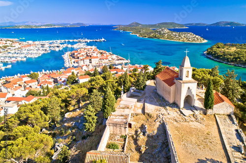 Poster de jardin Europe Méditérranéenne Dalmatian town of Tribunj church on hill and amazing turquoise archipelago aerial view