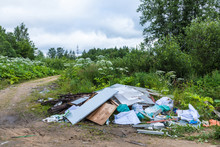 The Unauthorized Dump Of Garbage Among The Wild Nature Near The Industrial And Living Areas