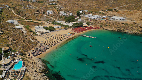 Poster de jardin Europe Méditérranéenne Aerial drone photo of iconic organised beach of Super Paradise with emerald clear sandy seascape, Mykonos island, Cyclades, Greece