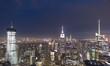 Top view of Manhattan buildings at night, New York.