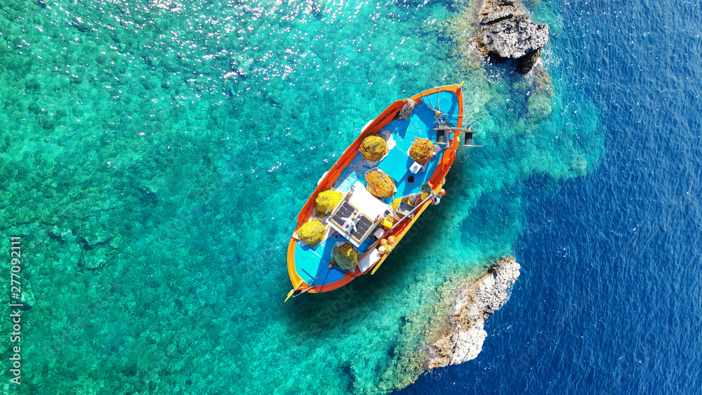 Fototapety, obrazy: Aerial drone top view photo of red wooden traditional fishing boat in deep turquoise sea shore of Lefkada island, Ionian, Greece