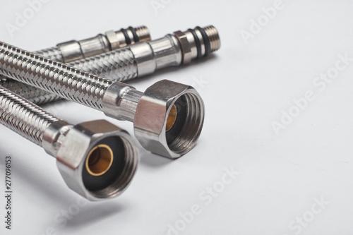 Carta da parati Two metal plumbing hoses on a white background