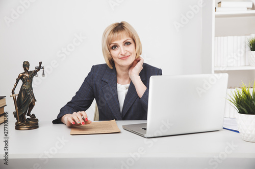 Woman jurist working laptop in office isolated Canvas Print