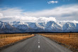 canvas print picture - A long straight road leading towards a snow capped mountain in New Zealand.