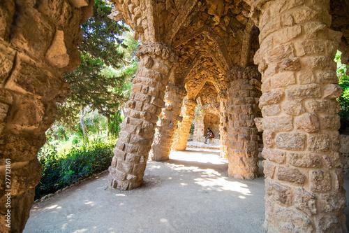Foto auf AluDibond Barcelona BARCELONA, SPAIN - April, 2019: Stone walkway in the Park Guell in Barcelona, Spain.