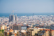 Barcelona, Spain - April, 2019: View of Barcelona city and costline in spring from the Bunkers in Carmel neighborhood. Few building stand out like sagrada familia and Agbar tower