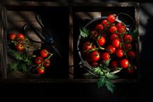 Overhead View Of Cherry Tomatoes On Wooden Tray
