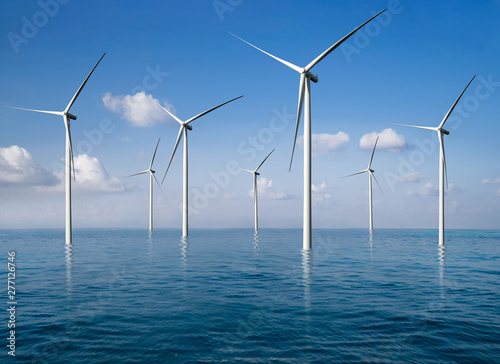 Wind turbine farm power generator in beautiful nature landscape for production of renewable green energy is friendly industry to environment Fototapeta
