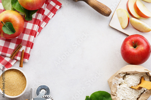 Photo  Ingredients and tools for making an apple pie.