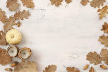 Autumnal Still Life With Oak Leaves, Acorns, Pumpkin And Candles
