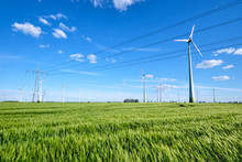 Power Lines And Wind Engines On A Sunny Day Seen In Germany