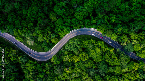 Forest Road view from above, Aerial view asphalt road in tropical tree forest with a road going through with car, Adventure in Asia background concept Fototapete