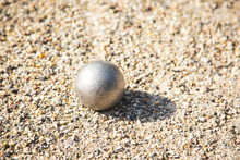Close Up Of Bocce Ball Or Metallic Petanque Ball On Gravel