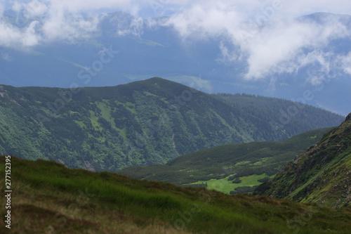 Fototapeta Beautiful green mountains hills and cloudy blue sky obraz na płótnie