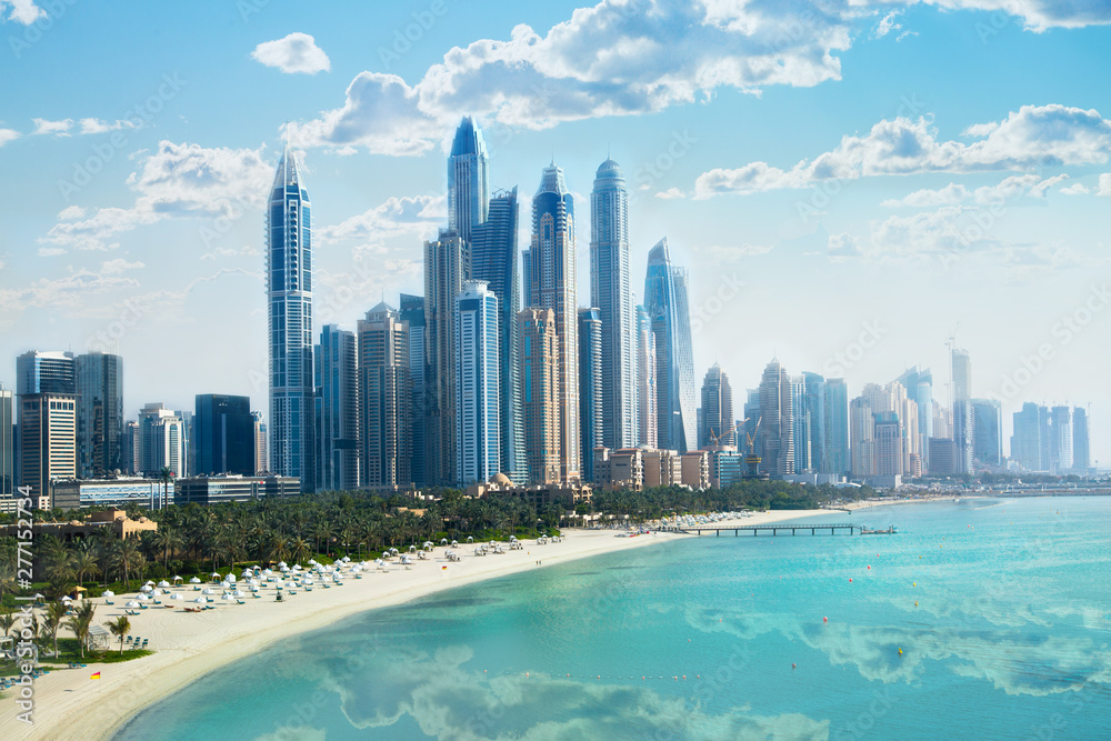 Fototapety, obrazy: Dubai, UAE United Arabs Emirates. City of skyscrapers, Dubai marina in the sunny day with front line of beach hotels and blue water of Persian gulf