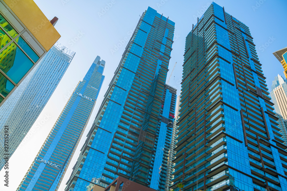 Fototapety, obrazy: Dubai marina skyscrapers at sunset. View against of blue sky from the Amaar walk. Apartments, hotels and office buildings of UAE