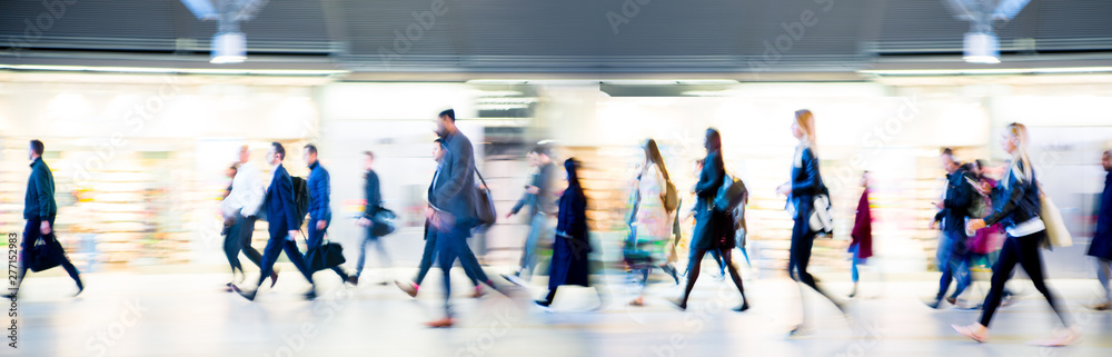 Fototapeta Beautiful motion blur of walking people in train station. Early morning rush hours, busy modern life concept. Ideal for websites and magazines layouts