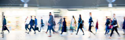 Beautiful motion blur of walking people in train station Wallpaper Mural