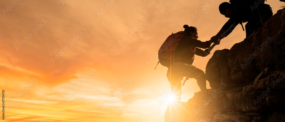 Fototapety, obrazy: Group of Asia hiking help each other silhouette in mountains with sunlight.