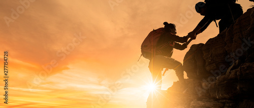Fototapeta Group of Asia hiking help each other silhouette in mountains with sunlight. obraz