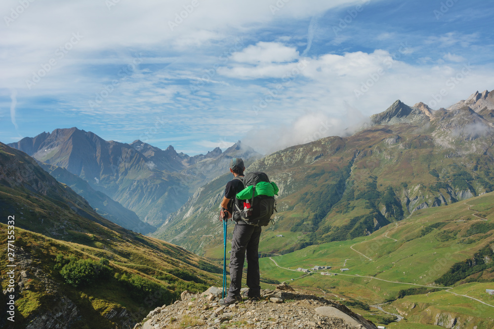 Fototapety, obrazy: A hiking trip with a backpack of alpine mountains.