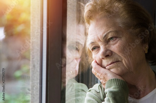 portrait of senior woman looking out the window