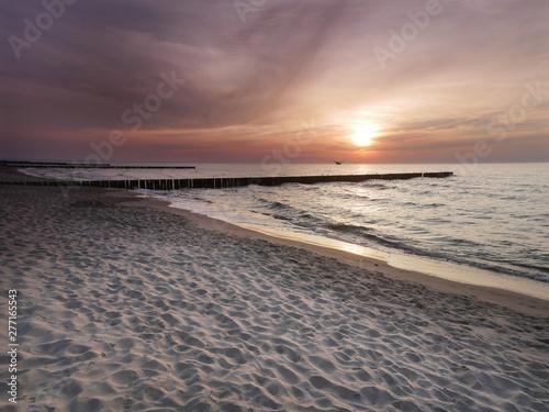 Fototapeta Morze zachód słońca - Dziwnówek Dziwnowo Falochrony obraz