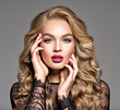 canvas print picture Blond woman with long curly beautiful hair. Makeup. Fashion make-up.
