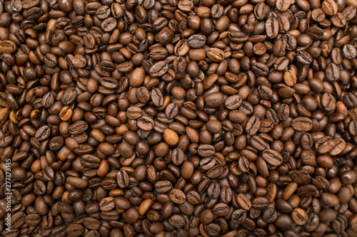 Foto op Plexiglas koffiebar Roasted coffee beans brown seeds texture background wallpaper.