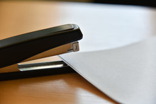 Stapler With Paper On The Office Table