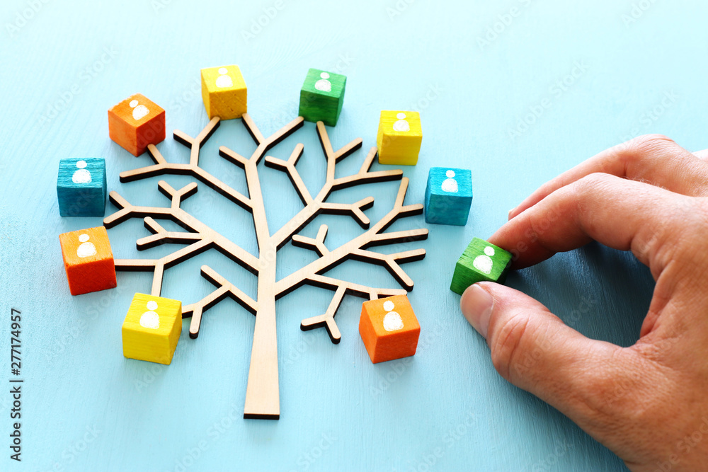 Fototapety, obrazy: Business image of wooden tree with people icons over blue table, human resources and management concept