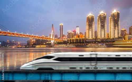 High-speed rail speeds on Bridges and the modern city skyline of chongqing, Chin Fototapeta