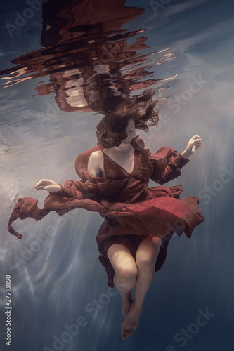 Girl in a red dress under water Poster Mural XXL