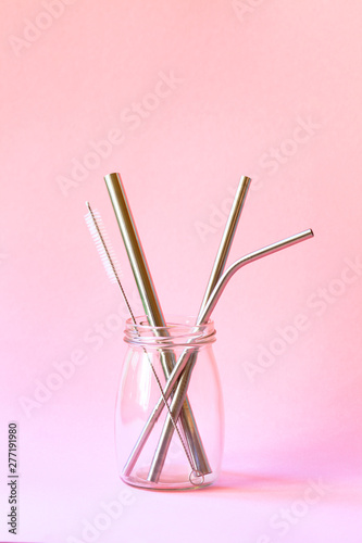 reusable stainless steel straws and cleaning brush in glass