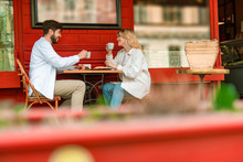 Happy Young Couple Having Date In Outdoor Cafe