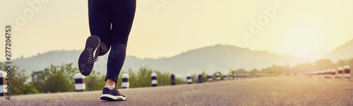 Fototapeta close up of woman leg in running start to reach the goal. Jogging workout and sport healthy lifestyle concept. proportion of the banner for ads. obraz