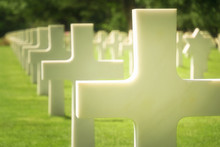 White Cross Grave Closeup, US Military Graveyard, Normandy American Cemetery, France. Selective Focus.