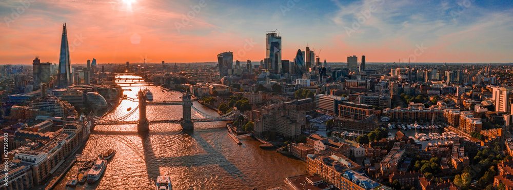 Fototapety, obrazy: Arial view of London with the River Thames floating through the city near the Tower Bridge, London City and Westminster Abbey.